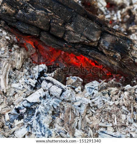 Burned charcoal and ash from fire - stock photo