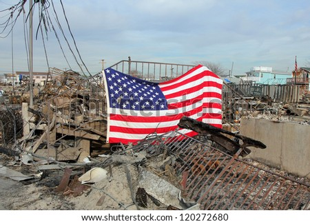 Burned houses with American flag - stock photo