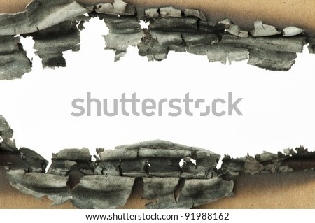 Burned paper and close up hole - stock photo