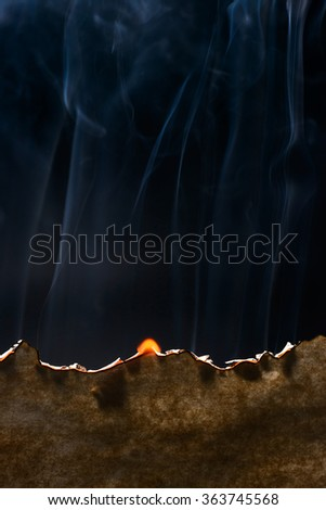 Burned paper edge - stock photo