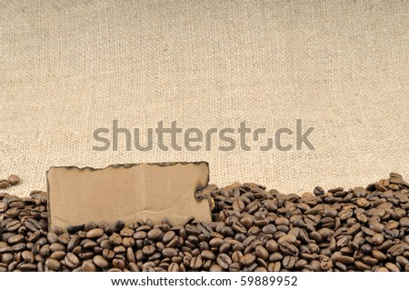 Burned tag on coffee beans and jute background - stock photo
