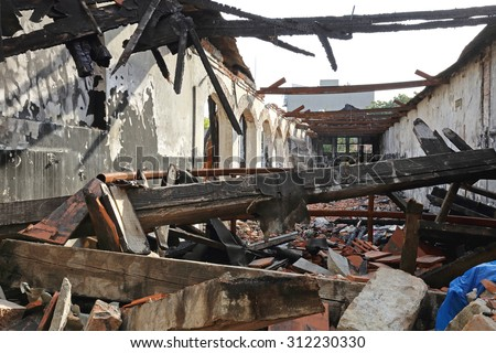 Burned Wooden Structure in Factory After Fire Disaster - stock photo