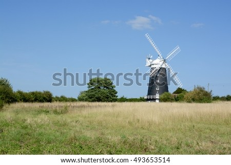BURNHAM OVERY STAITHE, UK - AUGUST 30, 2016: The tower Windmill, built in 1816 was used as a corn mill until damaged by a storm, Norfolk, UK