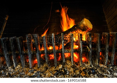 Burning and glowing pieces of wood in Fireplace - stock photo