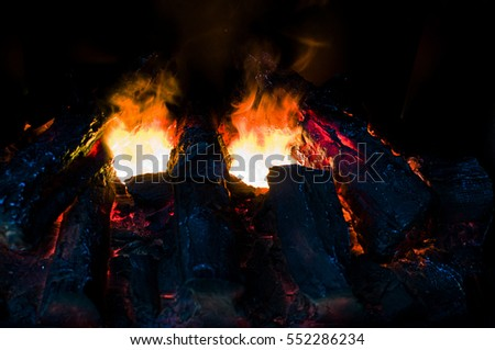 Burning and glowing pieces of wood in Fireplace