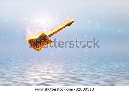 Burning bass guitar over clean pure ocean represents pure form of music - stock photo