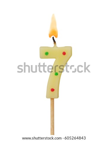 stock-photo-burning-birthday-candle-isol
