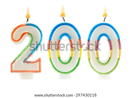 Burning birthday candles isolated on white background, number 200
