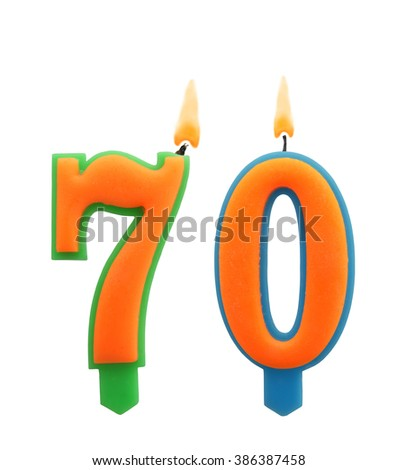 Burning birthday candles isolated on white background, number 70