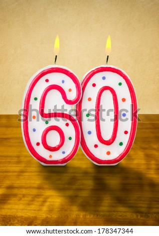 Burning birthday candles number 60 - stock photo