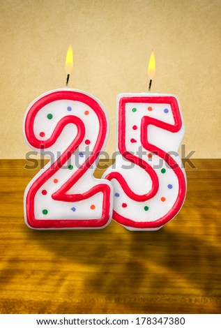 Burning birthday candles number 25 - stock photo
