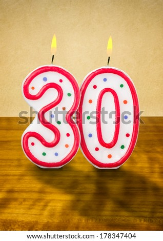 Burning birthday candles number 30 - stock photo
