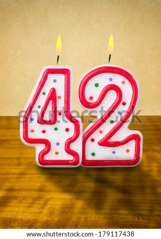 Burning birthday candles number 42 - stock photo