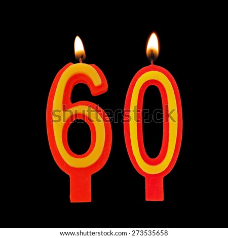 Burning birthday candles on black, number 60 - stock photo