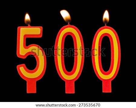 Burning birthday candles on black, number 500 - stock photo