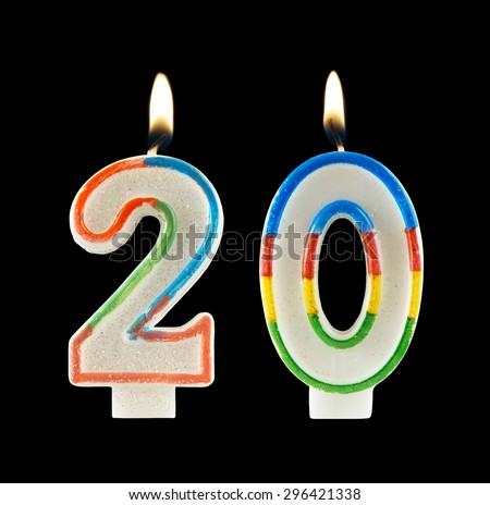 Burning birthday candles on black, number 20 - stock photo