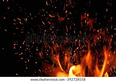 burning bonfire and spark in dark - stock photo