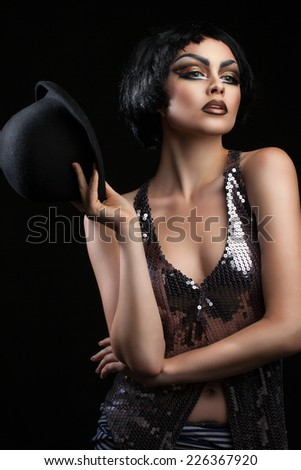 burning bright and brunette on a black background - stock photo