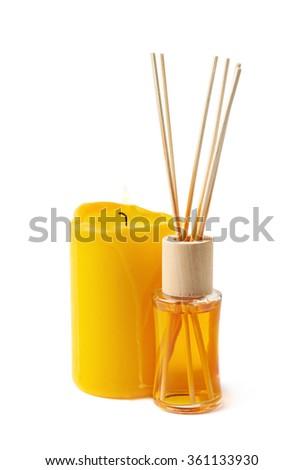 Burning candle and aroma sticks isolated - stock photo