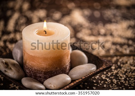 Burning candle for aromatherapy session - stock photo