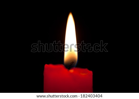 Burning candle in the dark