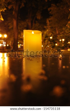 Burning candle on a table  - stock photo