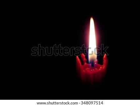 burning candle on the black background - stock photo