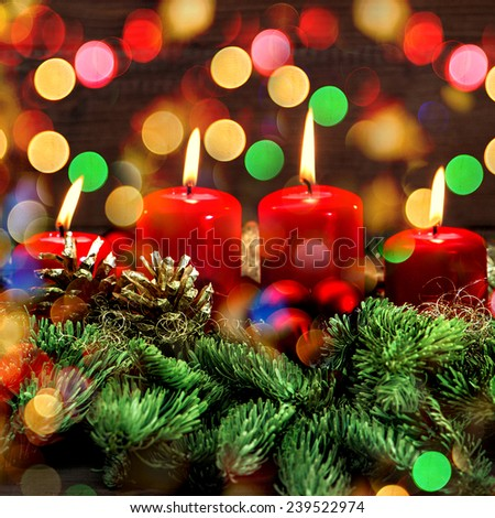 burning candles and wonderful lights. advent decoration. holidays background. selective focus, vintage style toned picture