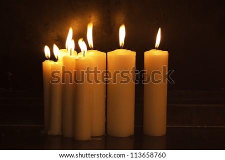Burning candles in dark - stock photo