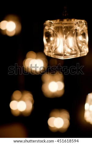 burning candles in glass vase - stock photo