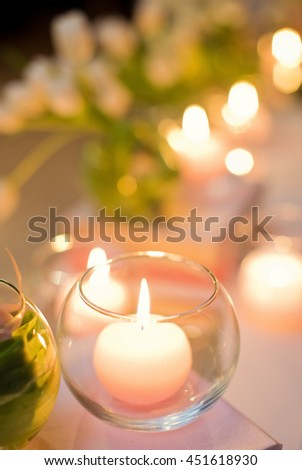 burning candles in glass vases - stock photo