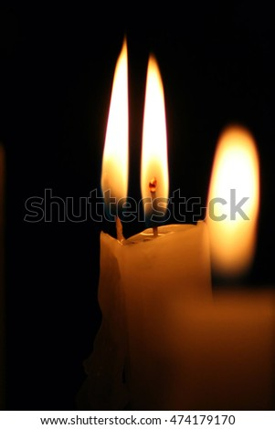 Burning candles in the darkness