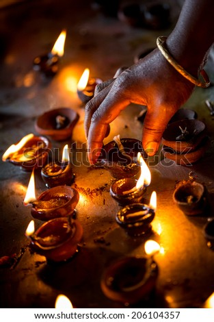 Burning candles in the Indian temple. Diwali the festival of lights.