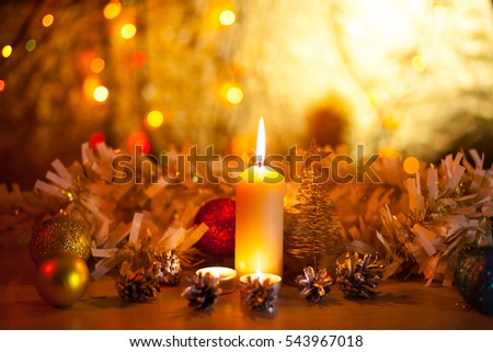 Burning candles in the New Year, Christmas decorations on a blurred background bokeh