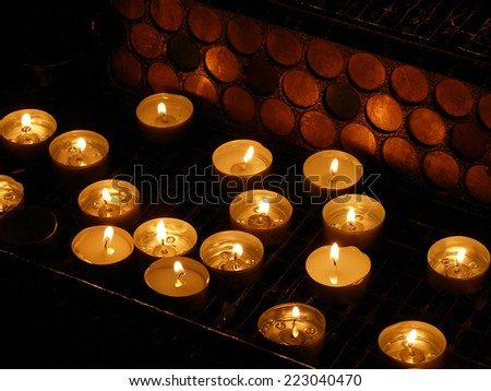 Burning candles on a dark background. Burning candles