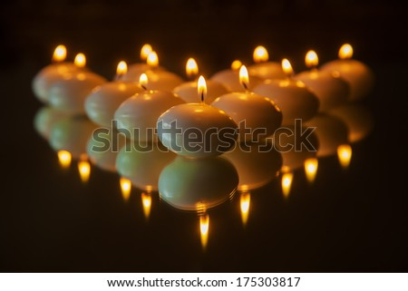burning candles on a mirror