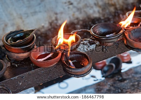 Burning candles on altar in Buddhist temple, Sri Lanka - stock photo