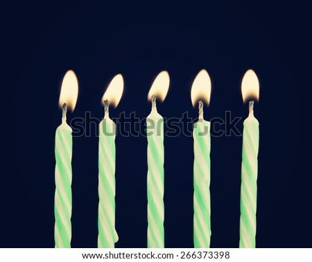 Burning candles on blue background - stock photo