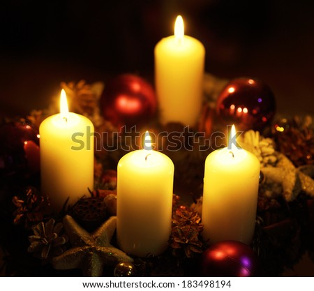 Burning candles on christmas wreath