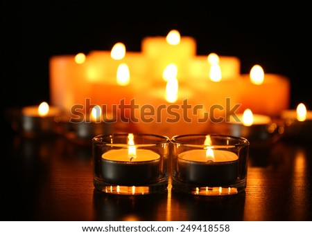 Burning candles on dark background