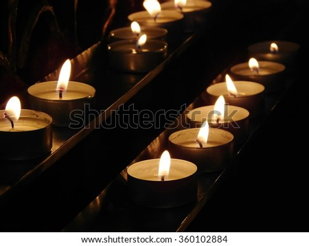 burning candles; shallow depth of field