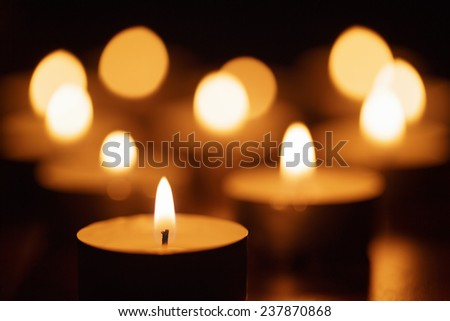 burning candles with beautiful out of focus, shallow DOF - stock photo