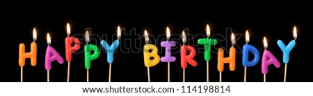 "Burning candles with the words ""Happy Birthday"" - stock photo"
