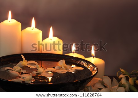 Burning candles with white orchid flower for zen concept. - stock photo