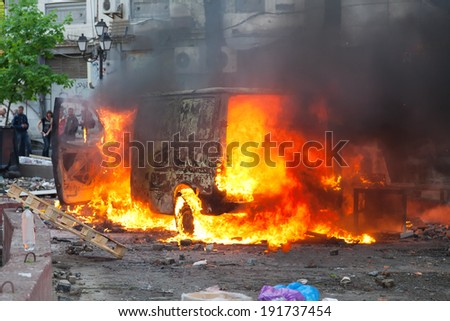Burning car in the center of city during unrest in Odesa, Ukraine  - stock photo