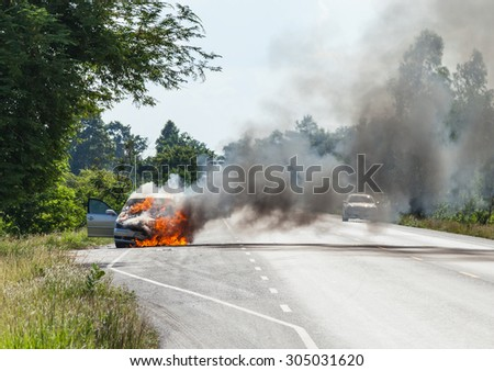 Burning cars on the road. - stock photo