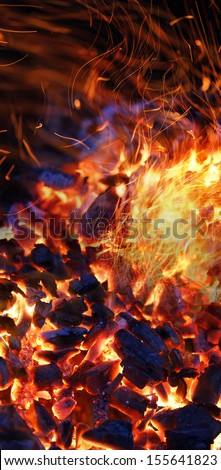 burning charcoal background with fire and sparks