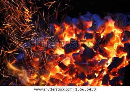 burning charcoal background with fire and sparks - stock photo