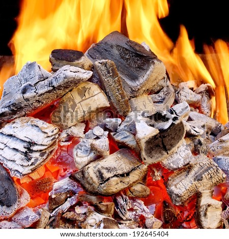 Burning Charcoal in BBQ close-up and Flames in background. You can see more BBQ, Grilled food, flames and fire on my page. - stock photo