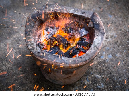Burning charcoal in stove - stock photo